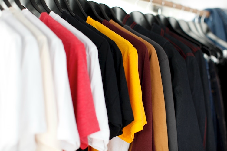 Cotton shirts hung on a rack at a dry cleaning facility